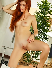"""Stunning redhead Mia Sollis makes another fiery red set as she poses for Luca Helios' camera"""